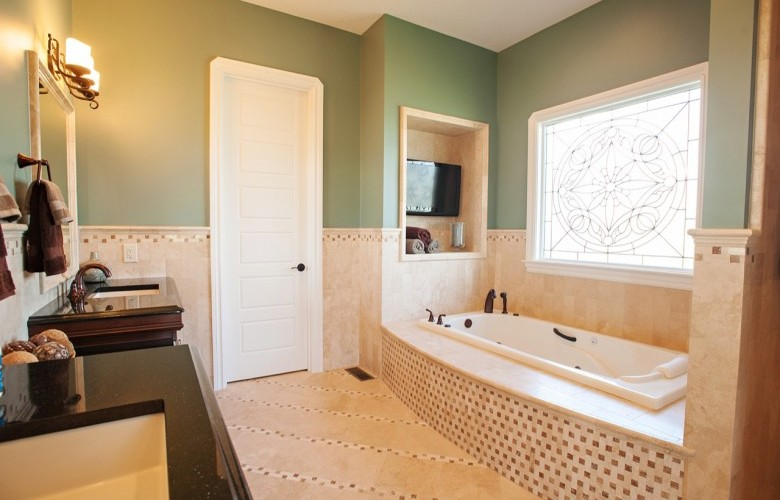 Master Bathroom with travertine tile and whirlpool tub