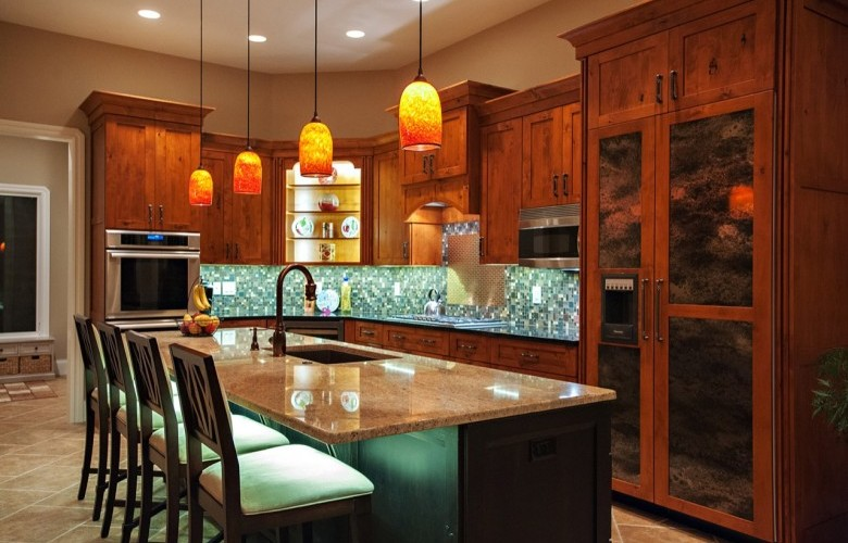 Eat-in Kitchen with custom cabinetry, granite countertops and Thermador appliances